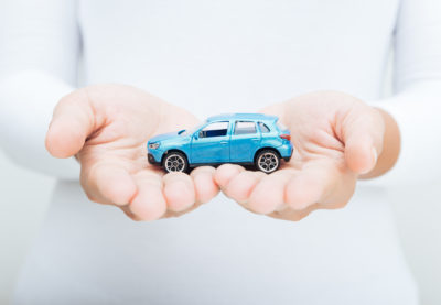 woman hand holding car business concept